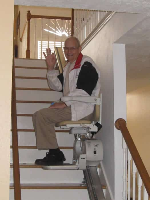 Barrier Free Plus customer enjoying his new straight stair lift in his home.
